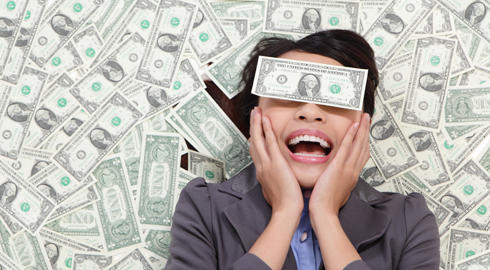 Young business woman excited lying on money background and money cover her eyes, asian beauty model